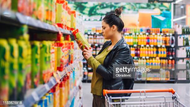 woman groceries shopping - ingredient stock pictures, royalty-free photos & images