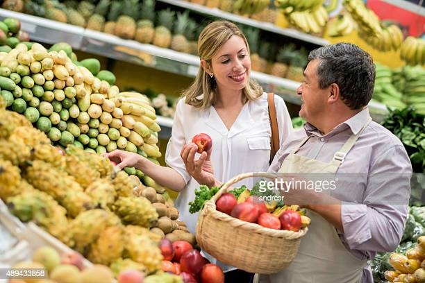 Woman grocery shopping at the food market