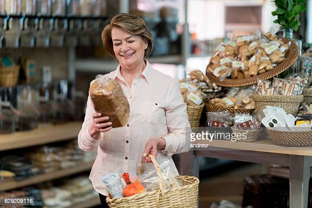 Woman grocery shopping at the supermarket