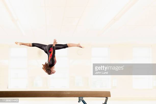 woman gymnast on the balance beam - balance beam stock pictures, royalty-free photos & images