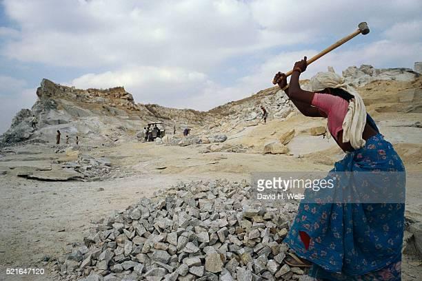 Woman Hammering Granite Rock