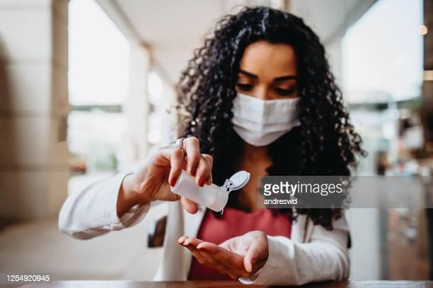 woman hand care - alcool gel imagens e fotografias de stock
