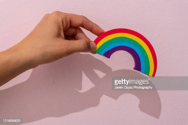 woman hand holdind a rainbow - equality stock pictures, royalty-free photos & images