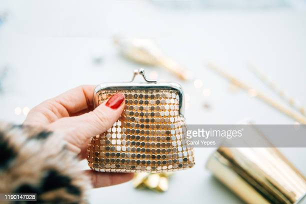 woman hand holding a golden walet - gold purse stock pictures, royalty-free photos & images