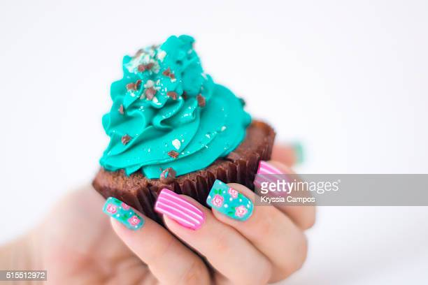 Woman hand holding a Mint - cholate cupcake
