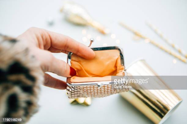 woman hand holding empty wallet in xmas - grandma invoice stock pictures, royalty-free photos & images