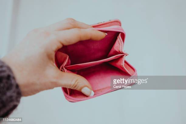 woman hand holding empty wallet - poverty stock photos and pictures