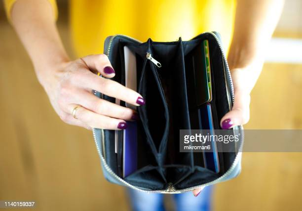 Woman hand holding empty wallet