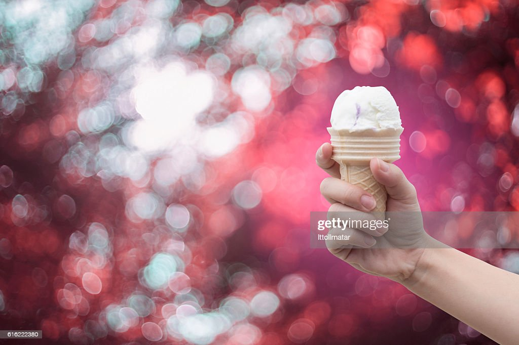 woman hand holding Ice cream with summer blue sky : Stock Photo