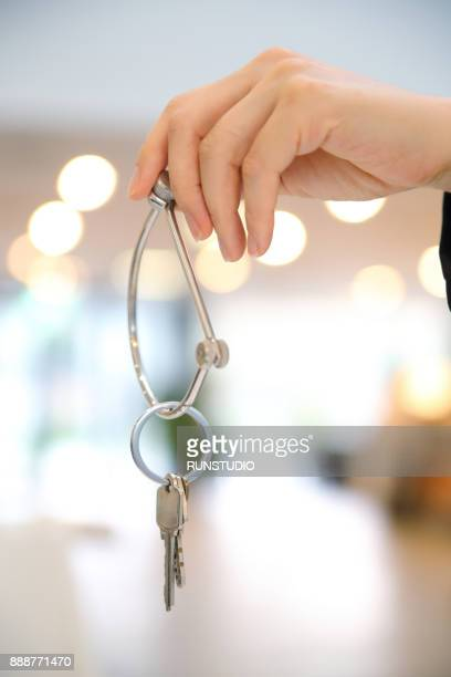 Woman hand holding key ring
