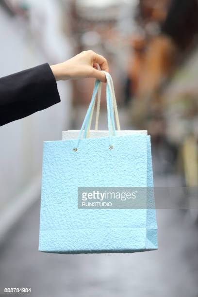 Woman hand holding shopping bags