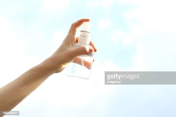 Woman Hand Holding Spray