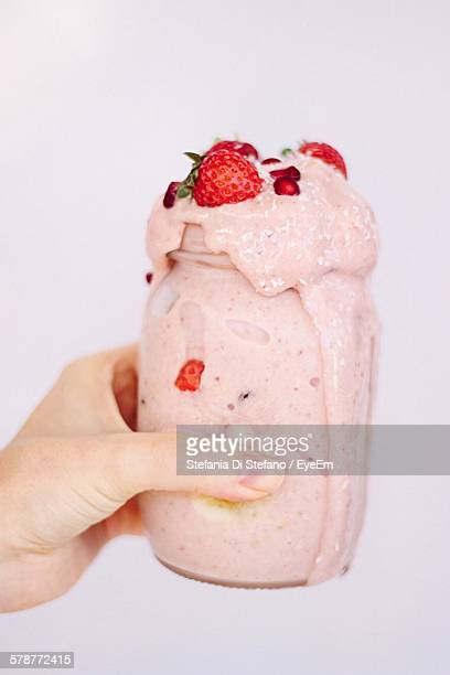 Woman Hand Holding Strawberry Smoothie