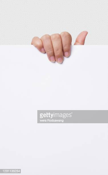 woman hand holding up the empty white a paper isolated with clipping path - afferrare foto e immagini stock