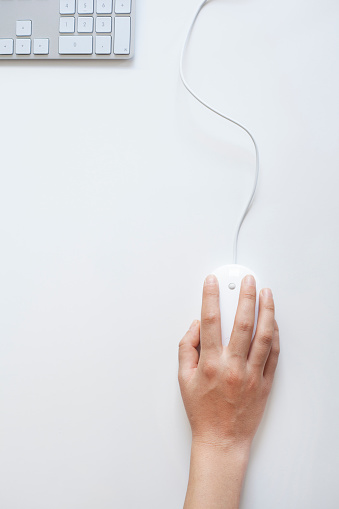 Woman hand on mouse 613542738