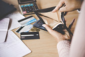 woman hand open empty purse looking for money having problem bankrupt broke