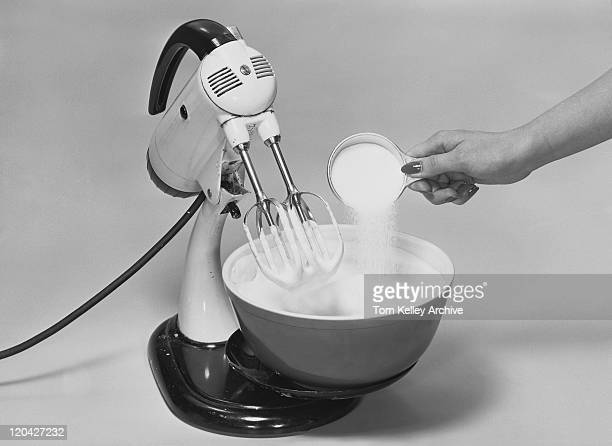 woman hand pouring icing sugar in bowl with cream, close-up - sugar bowl crockery stock photos and pictures
