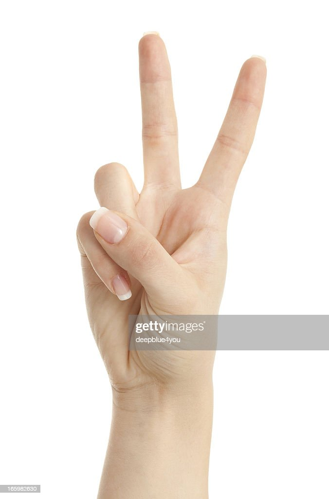 Woman hand showing peace sign isolated on white background : Stock Photo
