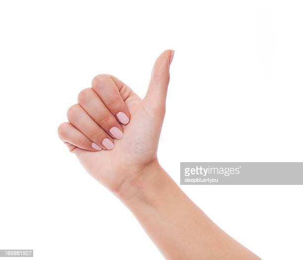woman hand showing thumb up on white - ok stock pictures, royalty-free photos & images