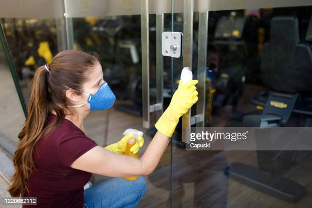 woman hand spraying alcohol sanitizer on door handle - cleaner stock pictures, royalty-free photos & images