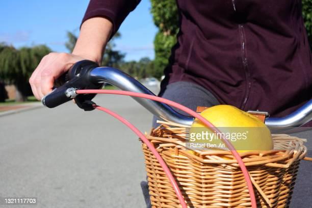 woman hand steering a handlebar of a bicycle - rafael ben ari foto e immagini stock