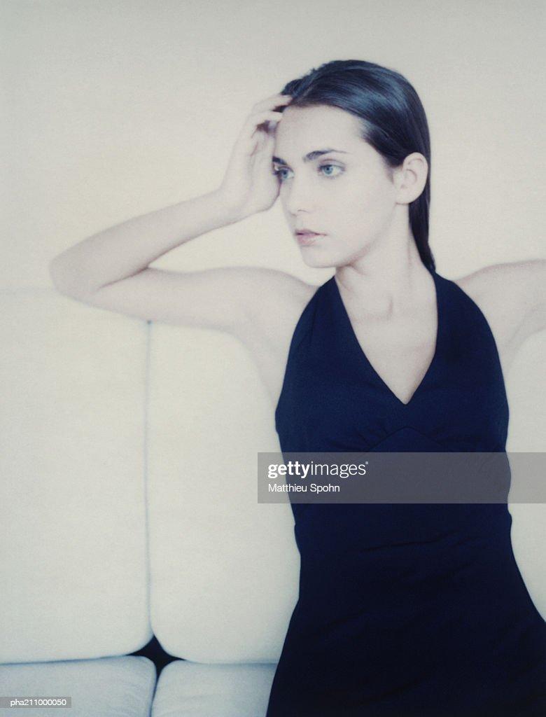 Woman, hand to her head. : Stockfoto