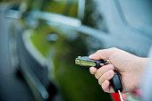 Woman hand unlocking a car