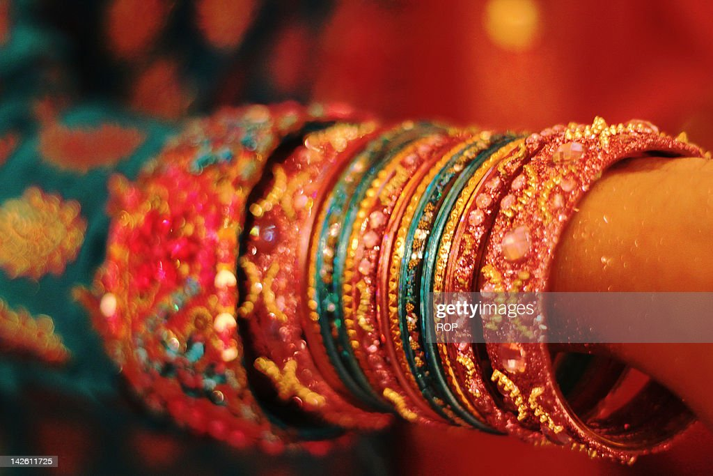 Woman Hand With Bangles Stock Photo | Getty Images