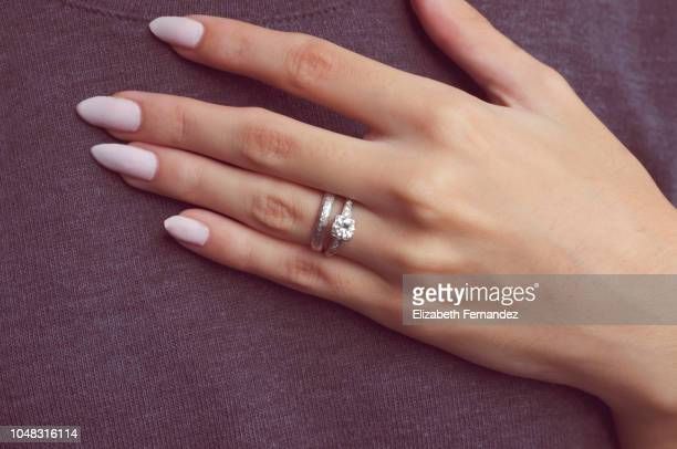 woman hand with engagement ring - wedding ring stock pictures, royalty-free photos & images