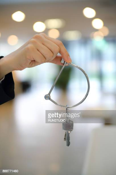 Woman hand with key ring