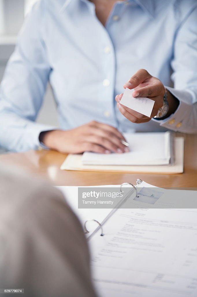 Woman handing out business card : Stock Photo