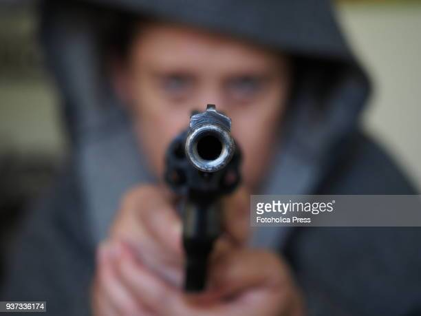 Woman handling pointing and shooting a gun a long barrel 38 special Taurus revolver while training for self defense