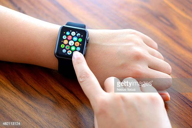 Woman hands and Black Apple Watch Sport
