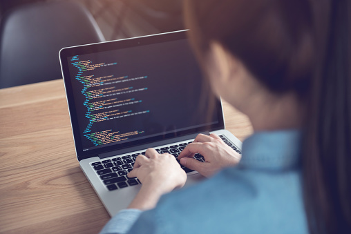 Woman hands coding html and programming on screen laptop, Web, developer. 960937636