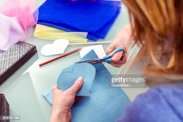Woman Hands Cutting Heart Shape From Felt Fabric