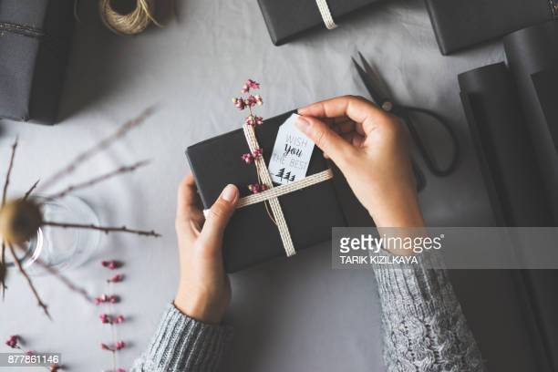 woman hands gift wrapping christmas presents, wish you the best - gift card imagens e fotografias de stock