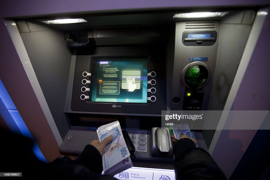 Woman Hands Giving Money to ATM : Stock Photo