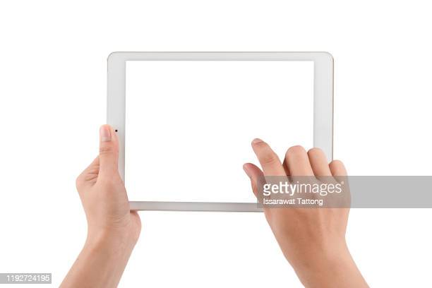 woman hands holding a tablet isolated on white - zoom effect stock pictures, royalty-free photos & images