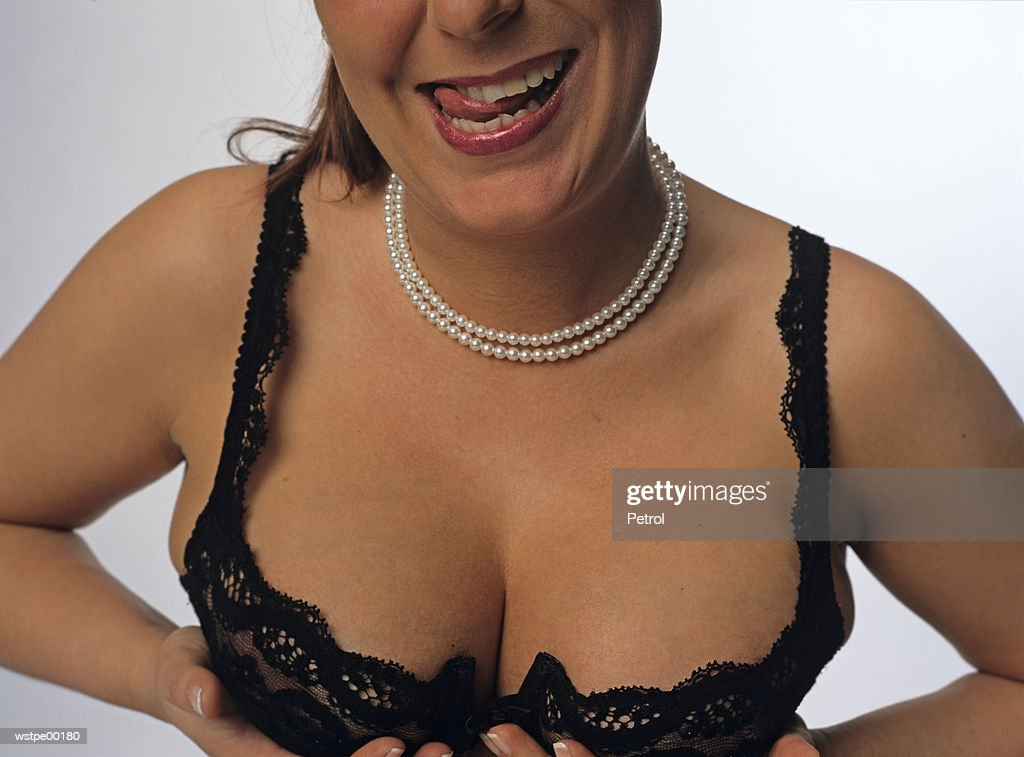 Woman, hands holding breast : Stockfoto