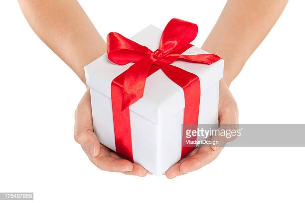 Woman hands holding gift