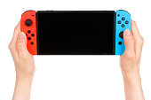 Woman hands holding Nintendo Switch console