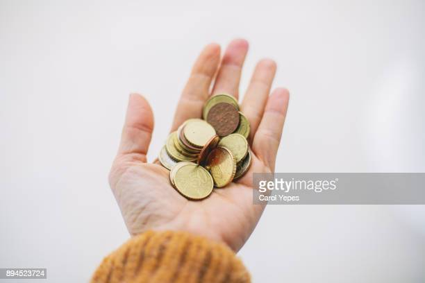 woman hands holding some coins