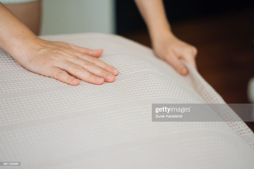 Woman Hands making a room bed : Stock Photo