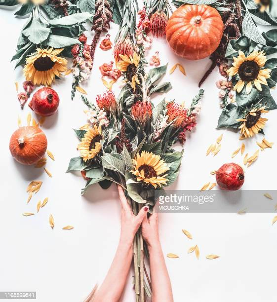 woman hands making autumn flowers bunch - floral decoration stock pictures, royalty-free photos & images
