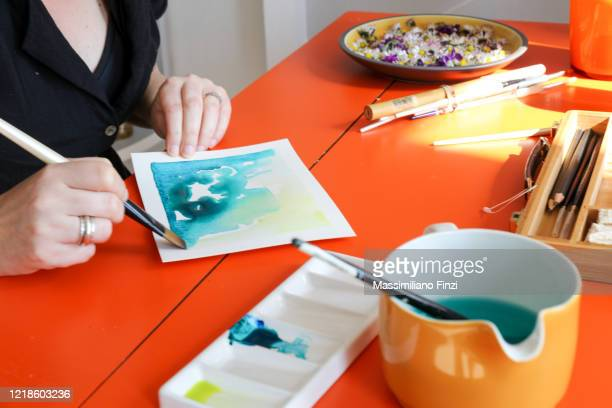 woman hands making watercolor painting at home - painting stock pictures, royalty-free photos & images