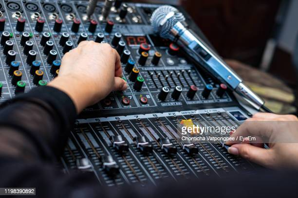 woman hands mixing audio by sound mixer analog in the recording studio - gol di pareggio foto e immagini stock