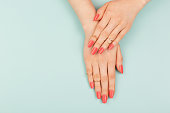Woman hands on blue background