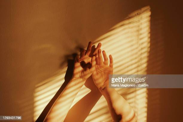 woman hands on wall at home - finger stock pictures, royalty-free photos & images