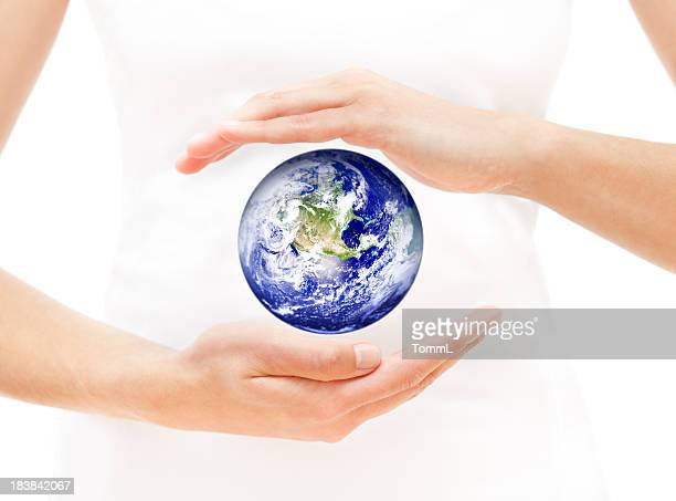 Woman Hands Protecting Earth