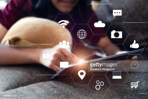 Woman hands touching tablet with virtual icon diagram network technology